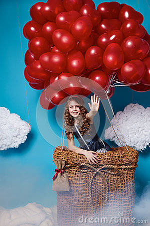 Free Small Cute Girl Flying On Red Heart Balloons Valentines Day Royalty Free Stock Photography - 49805587