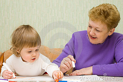 Small cute painting girl with grandma