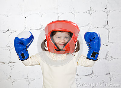 Portrait of the small dark-haired girl in a protective helmet an