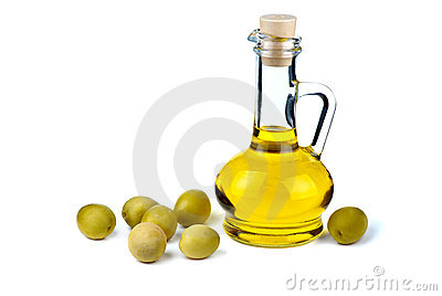 Small decanter with olive oil and some olives near