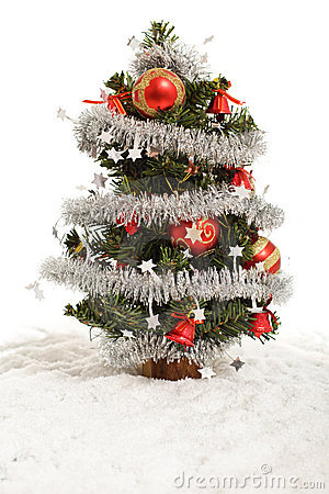Small decorative christmas tree in artificial snow