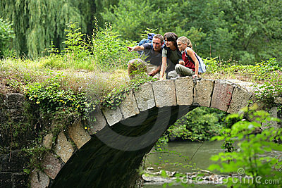 Small family on a bridge