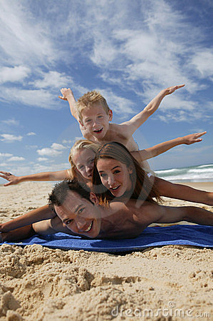 Small family lying on the beach