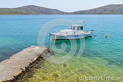 Small fishing boat at the coast of Crete