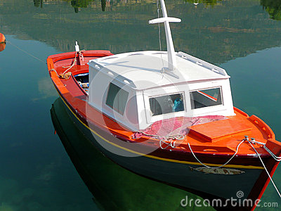 Small colorful half cabin wooden fishing boat, caique, Greece.