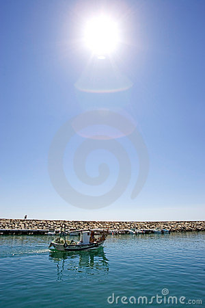 Small fishing boat leaving the port of Duquesa in Spain