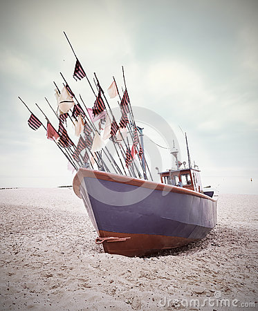 Free Small Fishing Boat On Shore Of The Baltic Sea. Stock Photos - 45721873