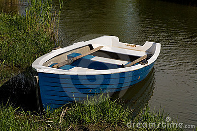 Small fishing rowboat floating
