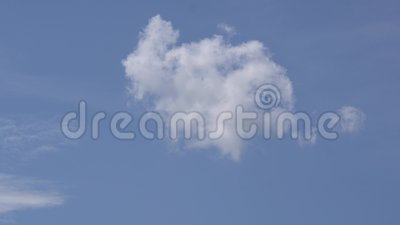 Small and fluffy cumulus cloud in the clean blue sky. stock video