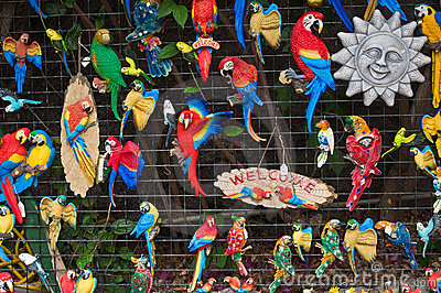 Small fridge magnets with parrots, welcome and sun