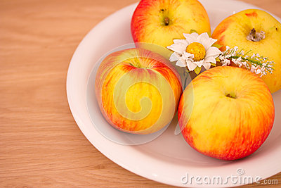 Small fuji apples on a plate