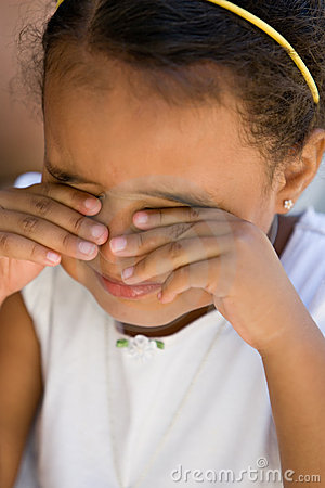 Small girl child rubbing eyes