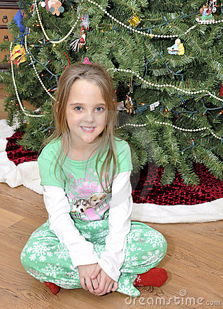 Small girl by Christmas tree