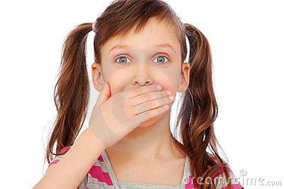 Small girl covering her mouth