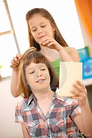 Small girl getting hair comb