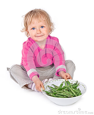 Small girl with grean peas