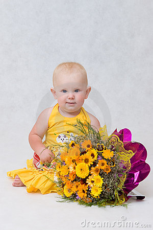 A small girl with a great flower bouquet