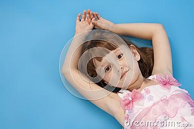 Small girl lies relax.