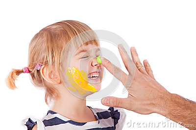 Small girl with paint on her cheek and nose