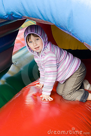 Small girl in play centrer.