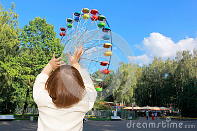 The small girl and Ferris wheel