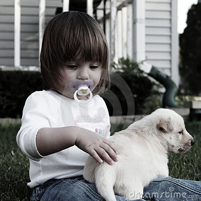 Small girl with puppy