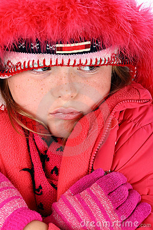 Small girl in red winter clothes isolated on white