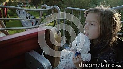 Girl rides teddy bear agree