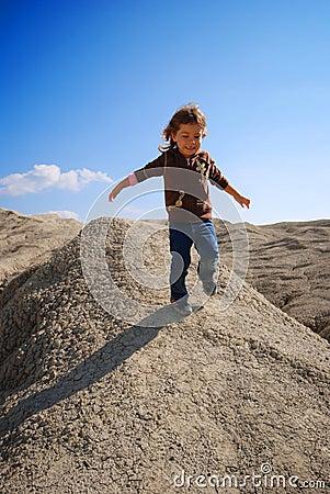 Small girl running down hill