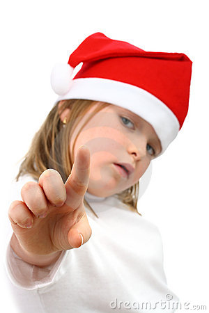 Small girl in Santa hat pointing finger at camera
