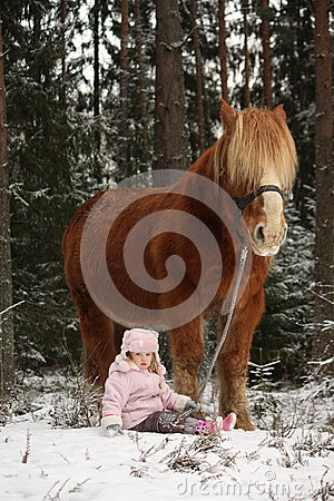 Free Small Girl Sitting In The Snow And Big Palomino Horse Standing N Royalty Free Stock Photography - 47898857