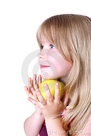 Small girl with yellow apple