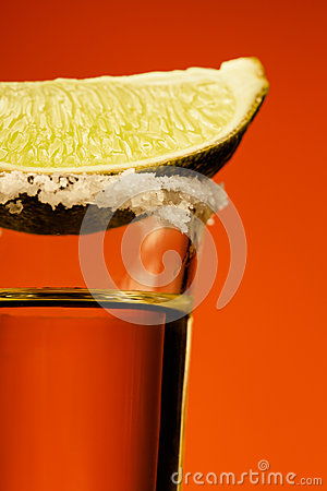 Small glass og tequila with lime