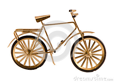 Small gold color toy bicycle isolated on white