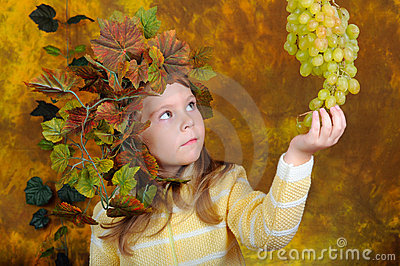 Small grape fairy with grapes in hands