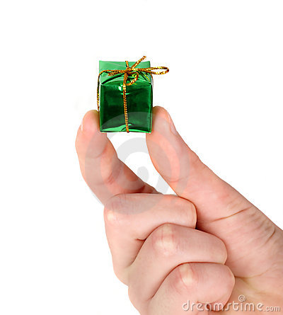 Small green present in man s hand