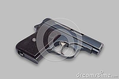 Small gun on neutral background