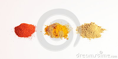 Small heap of spices, the turmeric powder, coriander powder and red chilli powder