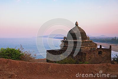 Small Hindu temple on the mountain near the sea