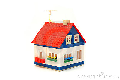 Small house constructed of toy blocks