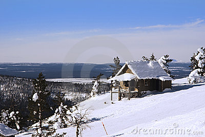 Small house on the hill in winter