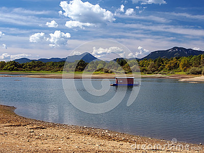 Small houseboat and shore in summer