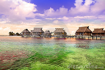 Small houses on water and Seacoast with palm trees