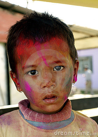A small kid playing Holi Editorial Photography