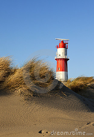 Small lighthouse and dunes at Borkum beach