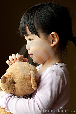 Small little kid with teddy bear