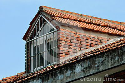 Small loft window on the top of building
