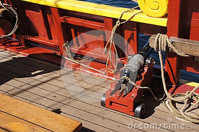 Small naval cannon on board