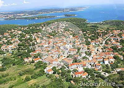 Small old city near blue sea