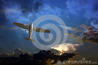 Small plane against a stormy sky